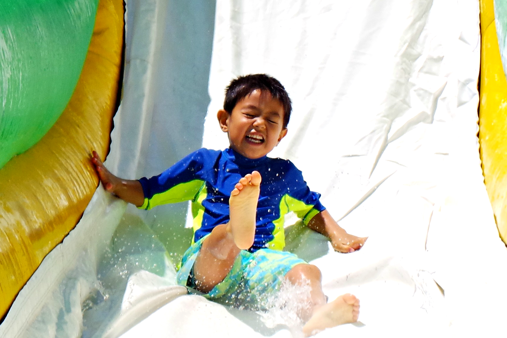 Explorer boy waterslide blue yellow shirt smile